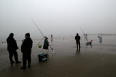 Fishermen in the mist on Saundersfoot beach, Pembrokeshire, Wales - Paul Box - 11-01-2004