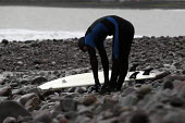 A surfer stretches before going surfing - Paul Box - 20-01-2004