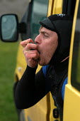 Surfer using an inhaler before going surfing for his asthma - Paul Box - 2000s,2004,and,asthma,asthmatic,asthmatics,athlete,athletes,breathing,condition,drug,drugs,HEA Health,Inhale,inhaler,inhalers,inhaling,LFL leisure,medical,medication,SPO Sport,sufferer,SURFE,surfer,su
