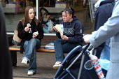 Teenage girls eat snacks in a shopping centre, Yate, nr Bristol - Paul Box - 02-02-2004