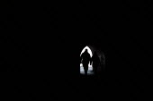 Walkers silhouetted in the entrance to a tunnel. Saundersfoot Pembrokeshire, West Wales - Paul Box - 01-11-2003