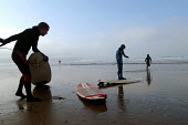 Father goes surfing with his sons, Woolacombe, Devon - Paul Box - 12-02-2004