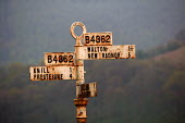 A rural signpost on a road in Wales. - Paul Box - 01-05-2004