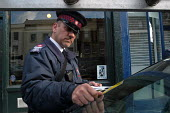 Parking attendant supervisor writes a parking ticket , Bristol - Paul Box - 03-03-2004