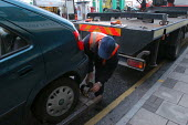 A tow truck removes a car from a clearway bus route, Bristol - Paul Box - 03-03-2004