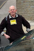 A driver makes light of his parking ticket by wearing it , Bristol - Paul Box - 2000s,2004,AUTO,AUTOMOBILE,AUTOMOBILES,AUTOMOTIVE,car,cars,cities,City,double,driver,DRIVERS,DRIVING,fine,highway,illegal,issues,job,jobs,lab lbr work,lines,no,offence,offense,PARKED,parking,parking t