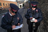 Parking attendant supervisor writes a parking ticket with newly trained attendant, Bristol - Paul Box - 03-03-2004