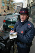 Female parking attendant , Bristol - Paul Box - 03-03-2004