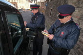 Parking attendant supervisor writes a parking ticket for a taxi with newly trained attendant, Bristol - Paul Box - 2000s,2004,attendant,attendant attendants,ATTENDANTS,car cars,cities,city,civil enforcement officer,contro,council services,council services,council worker,employee,employees,Employment,europeregi,fin