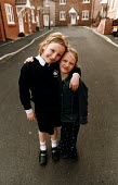 Social housing project near taunton. School children in the street on their housing estate - Paul Box - 01-08-2003