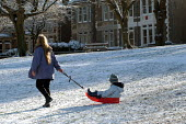 A mother, child and sledge, St Andrews park , Bristol - Paul Box - 2000s,2004,adult,adults,at,child,CHILDHOOD,children,Council Services,Council Services,families,FAMILY,FEMALE,juvenile,juveniles,kid,kids,landscape,LANDSCAPES,local authority,MATURE,mother,MOTHERHOOD,M