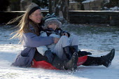 A mother, child and sledge, St Andrews park , Bristol - Paul Box - 2000s,2004,adult,adults,at,child,CHILDHOOD,CHILDREN,church,churches,Council Services,Council Services,FAMILY,FEMALE,juvenile,juveniles,kid,kids,landscape,LANDSCAPES,local authority,MATURE,mother,MOTHE