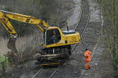 Workers replacing railway lines - Paul Box - 2000s,2004,apparel,bushes,clearing,clothing,debris,digger,digging,EBF Economy,EMPLOYEE,employees,ENGINEER,engineers,hard hats,HEA Health,job,jobs,LAB LBR work,laying,leaves,line,maintaining,MAINTENANC