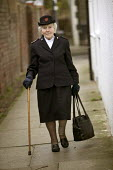 A 90 year woman who lives on her own in Bristol wearing her Salvation Army uniform. - Paul Box - 20-03-2004