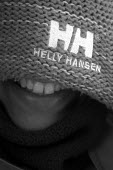 A young woman wearing a Helly Hanson hat laughs - Paul Box - 10-02-2004