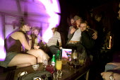 Women enjoy themselves at a bar in Bristol - Paul Box - 05-04-2004