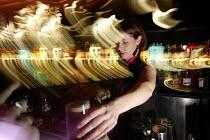 A female bar worker serves drinks at nightclub in Bristol - Paul Box - 05-04-2004