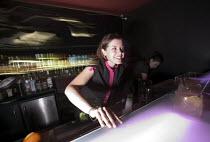 A female bar worker at nightclub in Bristol - Paul Box - 05-04-2004