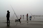Fisherman on the beach at Saundersfoot on a misty day - Paul Box - 10-01-2004
