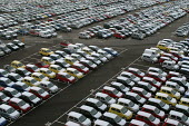 Rows of new cars imported to Portbury docks, Avonmouth Bristol - Paul Box - 2000s,2004,AUTO,auto industry,AUTOMOBILE,AUTOMOBILES,Automotive,boat,boats,capitalism,capitalist,car,Car Industry,carindustry,cars,cities,city,distributing,distribution,dock,docks,EBF Economy,export,e