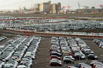 Rows of new cars imported to Portbury docks, Avonmouth Bristol - Paul Box - ,2000s,2004,AUTO,auto industry,AUTOMOBILE,AUTOMOBILES,Automotive,boat,boats,capitalism,capitalist,car,Car Industry,carindustry,cars,cities,city,distributing,distribution,dock,docks,EBF Economy,export,