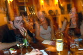 Pub goers at a pub quiz , Bristol   quiz - Paul Box - ,2000s,2003,ACE entertainment,air,alcohol,arms,bar,BARS,cities,city,drink,drinker,drinkers,drinking,drinks,friends,game,games,hands,having fun,hobbies,hobby,hobbyist,in,intelligence,intelligent,LFL Li