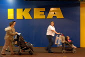 Ikea home furnishing store. Customers leave with their purchased items. - Paul Box - 05-05-2004