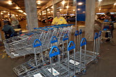 Ikea home furnishing store, loading area. An employee moves trollies. - Paul Box - 05-05-2004