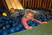 Ikea home furnishing store , a child plays in the instore creche - Paul Box - 2000s,2004,ball,balls,boy,BOYS,care,carer,carers,child,CHILD CARE,childcare,CHILD-CARE,CHILDHOOD,CHILDMINDING,children,CRECH,creche,CRECHES,Customer,Customers,EARLY,early years,facility,home,ikea,juve
