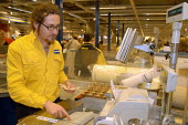 Ikea home furnishing store, a employee works at the check out - Paul Box - 2000s,2004,assistant,assistants,bought,buy,buyer,buyers,buying,checkout,commodities,commodity,consumer,consumers,customer,customers,EARNINGS,EBF Economy,furnishing,goods,home,ikea,Income,inequality,jo