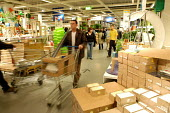 Ikea home furnishing store , customers shopping for home improvements - Paul Box - 2000s,2004,bought,BUY,buyer,buyers,buying,commodities,commodity,consumer,consumers,Customer,customers,EBF Economy,furnishing,goods,home,ikea,improvement,Leisure,LFL,LIFE,Lifestyle,PEOPLE,product,produ