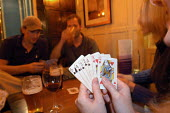 Pub goers play card games , Bristol   quiz - Paul Box - ,2000s,2003,ACE entertainment,alcohol,bar,BARS,bet,BETS,betting,card,cards,cities,city,drink,drinker,drinkers,drinking,drinks,friends,gambler,gambling,game,games,hand,having fun,hobbies,hobby,hobbyist