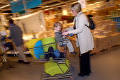 Ikea home furnishing store , customers shopping for home improvements. A mother and daughter shop together - Paul Box - 05-05-2004