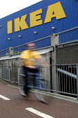 Ikea home furnishing store, a worker uses the company bicycle to get to work. - Paul Box - 2000s,2004,adult,adults,assistants,bicycle,BICYCLES,BICYCLING,Bicyclist,Bicyclists,BIKE,BIKES,COMMUTE,commuter,commuters,COMMUTING,commuting journey to from work lfl lifestyle,companies,company,CYCLE,