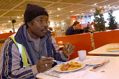 Ikea home furnishing store, breakfast for �1, a builder tucks into a cheap breakfast - Paul Box - 2000s,2004,and,BAME,BAMEs,black,BME,bmes,break,breakfast,builder,BUILDERS,cafe,cafes,catering,cheap,Customer,Customers,diversity,eat,eating,eats,EBF Economy,english,ethnic,ethnicity,fast,food,FOODS,fo