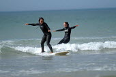 Girls learning to surf , Freshwater west, Pembrokeshire. - Paul Box - 01-03-2004