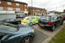 Police car speeding away, Lockleaze Bristol. - Paul Box - 30-06-2004