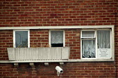 Resident looks out from behind the net curtains of her home, Lockleaze, Bristol where ASBO 's anti social behaviour orders have been issued in the area. - Paul Box - 30-06-2004