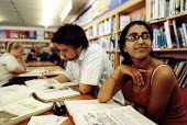 Marlwood school, Olveston nr Bristol, sixth form pupils revise for exams in the library - Paul Box - 2000s,2004,6th,A Level,A Level,adolescence,adolescent,adolescents,alevel,alevels,asian,BAME,BAMEs,black,BME,bmes,child,CHILDHOOD,children,cities,city,diversity,EDU Education,ethnic,ethnicity,EXAM,exam