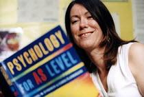 Marlwood school, Olveston nr Bristol, a psychology teacher with a textbook. - Paul Box - 15-06-2004