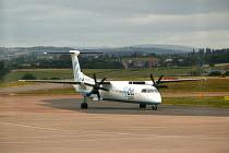 Exeter airport, aircraft taxiing along the runway. - Paul Box - 10-06-2004