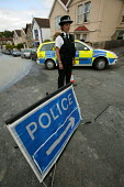Police officer attends a bust water main in Bristol, the road has been closed. - Paul Box - 10-06-2004