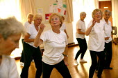 Elderly woman exercising at a keep fit class, Community Centre, Bristol. - Paul Box - 02-06-2004