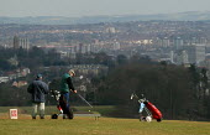 Golfers on a council run public golf course in Ashton Court, Bristol. - Paul Box - 2000s,2004,caddy,club,clubs,council,council services,council services,Court,golf,golfer,golfers,golfing,green,hobbies,hobby,hobbyist,holiday,holiday maker,holiday makers,holidaymaker,holidaymakers,hol