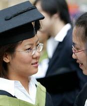 A Japanese student at a graduation ceremony, Bath. - Paul Box - 01-07-2004