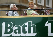 Bath tourists on an open top bus. - Paul Box - 01-07-2004