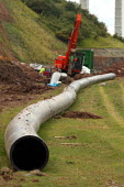 A sewage outlet pipe is cut through rock on the Severn estuary near the Severn bridge crossing. - Paul Box - 02-08-2004