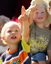 International kite festival, Bristol. Children watch the festival. - Paul Box - 05-09-2004