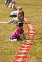 International kite festival, Bristol . Kids help with a dragon kite - Paul Box - 05-09-2004