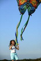 International kite festival, Bristol . A child plays with kite - Paul Box - 05-09-2004